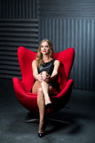 Sexy woman and red chair Stock Photography