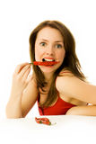 Woman with red chili peppers. Young brunette woman with red chili peppers isolated against white background stock photo