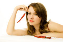 woman with red chili peppers Royalty Free Stock Photo