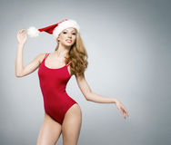 A sexy woman in red Christmas lingerie on a grey background Stock Photography