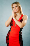 Sexy  woman in red dress. On a blue background Stock Images