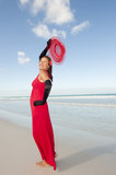 Sexy woman red dress beach Royalty Free Stock Image