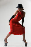 woman in red dress and black hat. Stock Image
