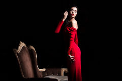 Sexy woman in red dress in darkness Royalty Free Stock Photo