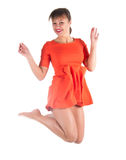 Sexy woman in red dress jumping Royalty Free Stock Image