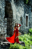Sexy woman in red dress in ruins Stock Photos