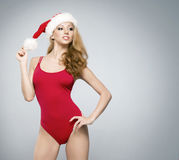 A sexy woman in red erotic Christm Stock Photos