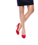 Sexy Woman in Red high heels. Close Up Legs of woman in heels isolated on white Royalty Free Stock Image