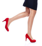 Sexy Woman in Red high heels. Close Up Legs of woman in heels isolated on white Stock Photography