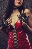 Woman. In red latex costume stock photo