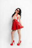 Sexy woman in red latex dress with sunglasses Royalty Free Stock Images