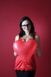 Sexy woman in red lingerie with balloon shape heart on red background Valentines day Stock Images
