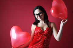 Sexy woman in red lingerie with two baloons shape heart on red background Valentines day Stock Photos