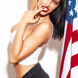 Sexy woman with red lips holding USA flag Stock Photography