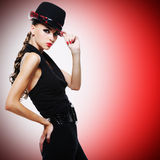 Sexy woman with red lips and nails in modern black hat Royalty Free Stock Photos