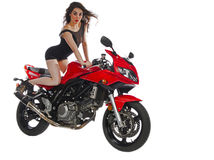 Sexy woman on red motorcycle Royalty Free Stock Photo