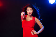 Sexy woman in red pointing on you at nightclub Royalty Free Stock Image
