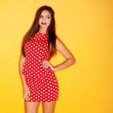 Sexy woman in red polka dot dress. Hot woman wearing red polka dots dress with black stiletto Stock Image