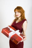 Sexy woman with red present on valentines day Royalty Free Stock Photo