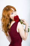 Sexy woman with red rose on valentines day. Sexy woman with red rose and artistik bright make-up on valentines day celebration Stock Photos