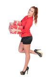 Sexy woman in red shirt and black shorts posing with gift box Stock Photos
