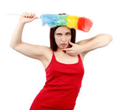 Sexy woman in red shirt with whisk for house dust Royalty Free Stock Images