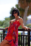 Sexy woman in a red sumer dress and sunglasses Stock Image