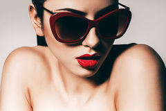 Sexy woman in red sunglasses Royalty Free Stock Photos