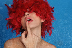 Sexy woman in red wig, with snow Royalty Free Stock Image