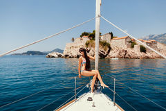 Sexy woman relax on yacht in sea Stock Images