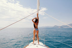 Sexy woman relax on yacht in sea Stock Photos