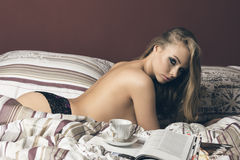 Sexy woman relaxed on bed Stock Photography