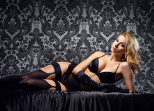 A sexy woman relaxing in erotic lingerie Royalty Free Stock Images