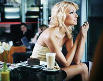 Sexy woman at a restaurant Royalty Free Stock Photo