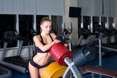 Sexy woman resting in gym Stock Image