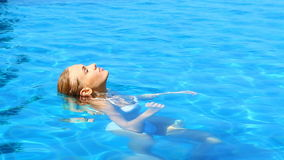 Sexy woman resting in swimming pool Stock Photos