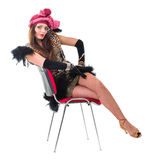 Sexy woman in retro dress on a chair Stock Photography