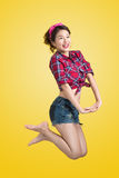 woman retro portrait with pin-up make-up and hairstyle pos stock image
