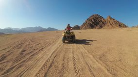 Sexy Woman is Riding a Quad Bike in the Desert of Egypt. Dynamic view in motion. stock video