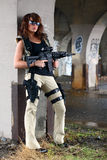 Sexy woman with rifle. A very sexy brunette with an assault rifle Stock Photo