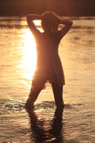 Sexy Woman in River in Sunset. Silhouette of sexy woman standing in the river in the sunset Royalty Free Stock Photos