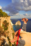 Sexy woman on the rock above azure sea Royalty Free Stock Photos