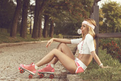 Sexy woman with roller skates Stock Photography