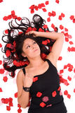 Sexy woman with rose petals. Stock Photography