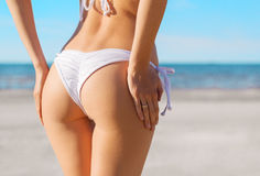 Sexy woman's buttocks in white bikini Royalty Free Stock Photo