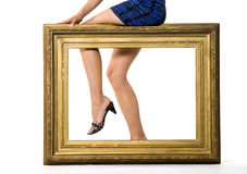 Sexy woman's legs behind Royalty Free Stock Photography