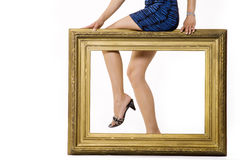 woman's legs behind a frame Stock Photos