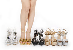 Sexy woman's legs with prom shoes collections Royalty Free Stock Images
