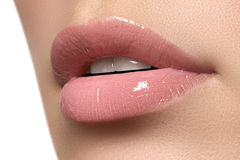 Sexy woman's lips. Beauty lips make-up. Beautiful make-up. Sensual open mouth. Lipstick and lip gloss. Natural full lips Stock Photos
