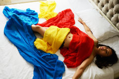 woman`s lying on the bed Stock Images